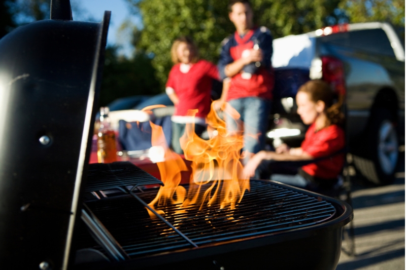 The grill is nearly ready for tailgate foods.