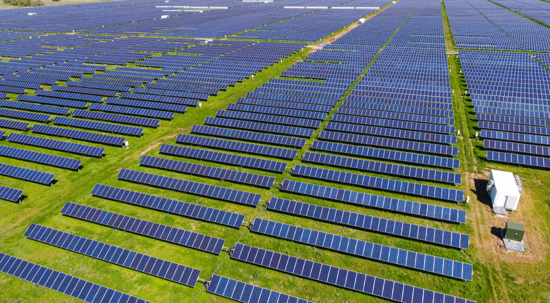 Solar farms can offset the carbon emissions from fossil fuels and benefit the environment.